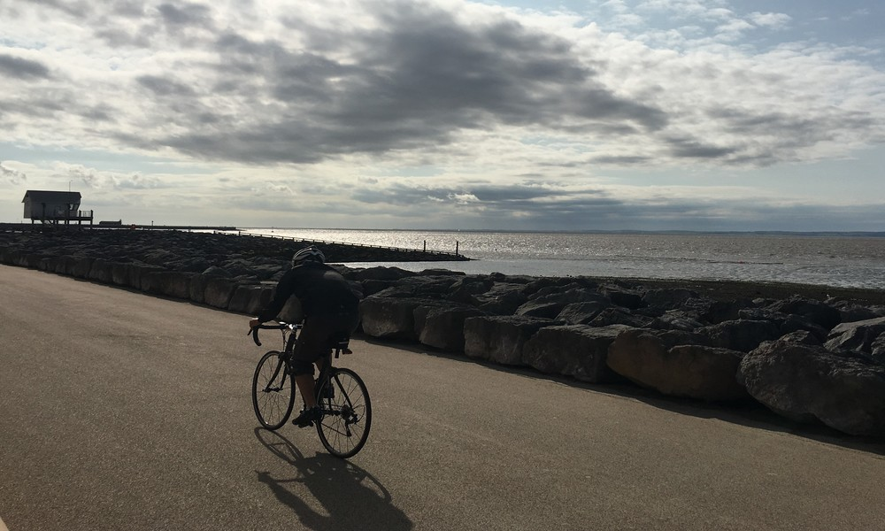 Man cycling Morecambe Bay